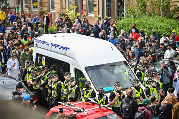 GBR: Protesters Block UK Home Office Van In Glasgow