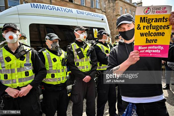Protestors block an immigration enforcement van, stopping it from leaving Kenmure Street in First Minister, Nicola Sturgeon's constituency on May 13,...