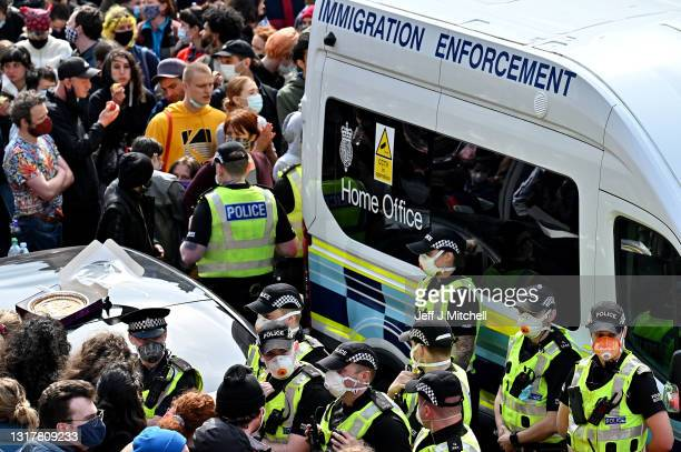 Protestors block an immigration van stopping it from leaving Kenmure Street in First Minister Nicola Sturgeon's constituency on May 13, 2021 in...