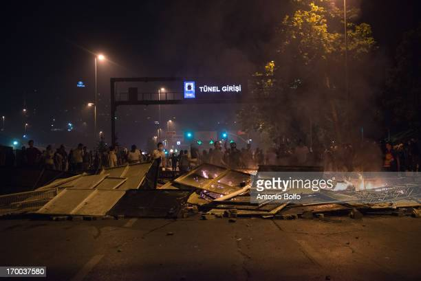 Protestors block off the tunnel June 2 2013 in Istanbul Turkey People started peacefully protesting the government's project to tear down Taksim's...