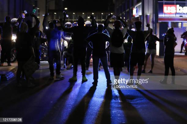 Protestors block the path of CMPD officers as they attempt to make an arrest near uptown Charlottec North Carolina on June 2 2020 US President Donald...