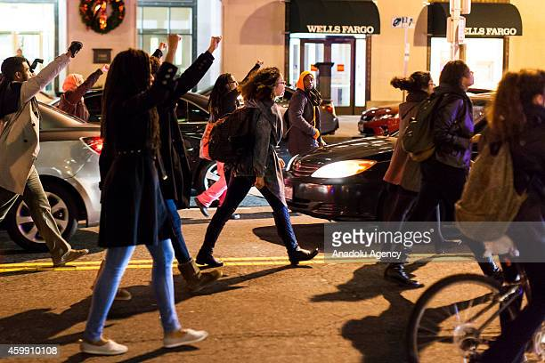 Protestors block the road during a protest after two grand juries decided not to indict the police officers involved in the deaths of Michael Brown...