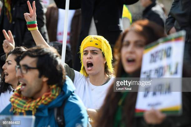 Protestors block traffic in Parliament Square as they demonstrate against Turkey's military strikes against the people of Afrin in northern Syria on...