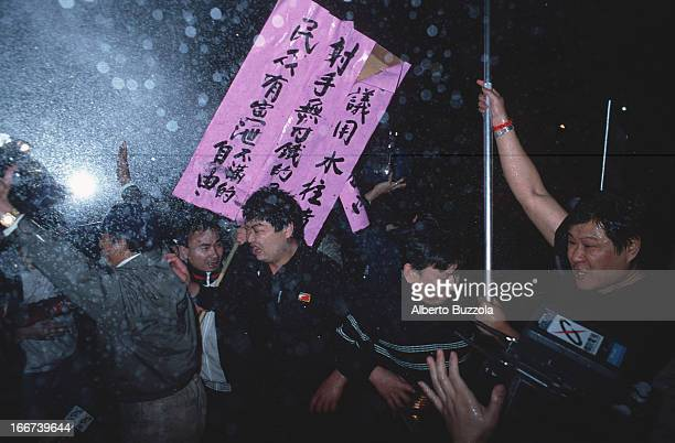 Protestors braving a police watercannon charge at a public demonstration following the KMT defeat in the country's second democratically held...
