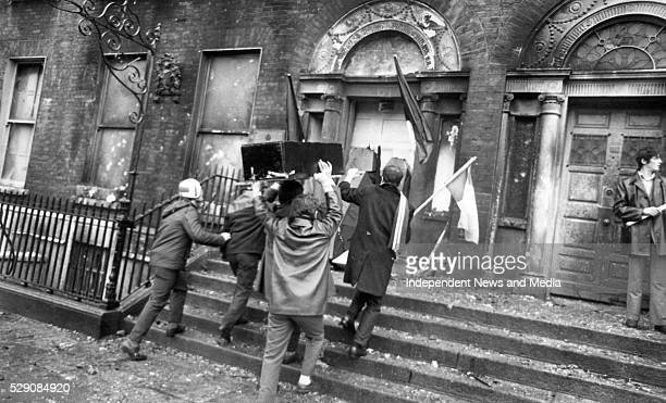 Protestors brining a mock coffin March to the burntout British Embassy on Merrion Sq that had been destroyed in the proterst the previous night The...