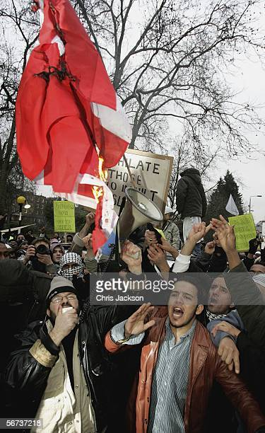 Protestors burn a Danish Flag outside the Danish Embassy February 3 2006 in London England Hundreds of British Muslims are protesting outside the...
