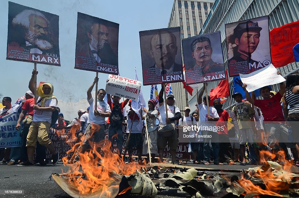 Protestors burn an effigy near the United States Embassy on May 1, 2013 in Manila, Philippines. Philippine workers unions gather in the streets of Manila to demand, among other things, better pay, an end to contractualization and layoff and the lowering of prices of basic commodities. Labor day is celebrated across South East Asia on May 1st and is seen as an opportunity to acknowledge the social and economic accomplishments of the workers.