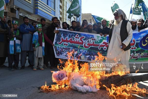 Protestors burn an effigy of Indian Prime Minister Narendra Modi during a demonstration to mark Kashmir Solidarity Day in Quetta on February 5, 2021.
