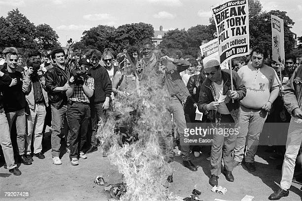 Protestors burn their Poll Tax documents in protest at what they see as an unfair levy London March 1990