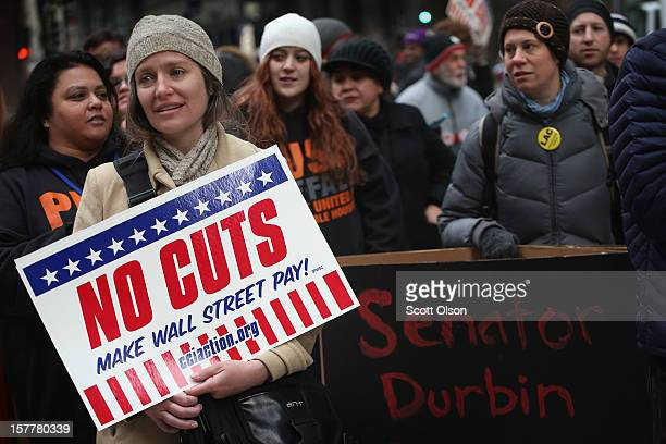 Protestors call for an increase of taxes on the wealthy and voice opposition to cuts in Social Security Medicare and Medicaid during a demonstration...