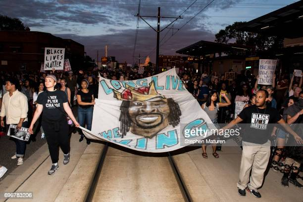 Protestors carry a banner depicting Philando Castile on June 16 2017 in St Paul Minnesota Protests erupted in Minnesota after Officer Jeronimo Yanez...