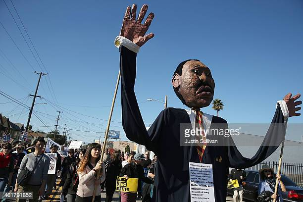 Protestors carry a large puppet of Martin Luther King Jr during a demonstration on January 19 2015 in Oakland California Thousands of protestors took...