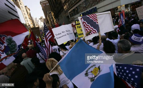 Protestors carry a sea of flags during a march down Broadway during a proimmigration rally in Union Square May 1 2006 in New York City Activists and...