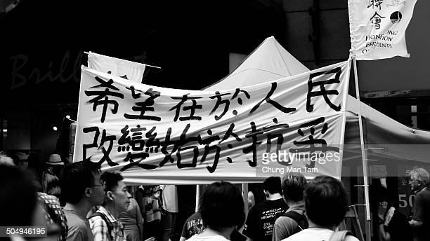 Protestors carry banners reading <The hope is in the people, the change begins with struggle> during a democracy rally seeking for universal suffrage...