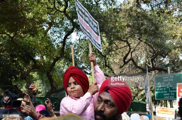Protestors carry placards demanding arrest of Congress leader Jagdish Tytler for his alleged involvement in the 1984 anti-Sikh riots in New Delhi....