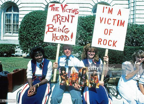 Protestors carrying placards gather outside the PMRC senate hearing at Capitol Hill Washington DC United States 18th September 1985 Representatives...