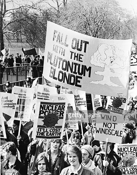 Protestors carrying posters and a large banner in an anti-nuclear power march in London.