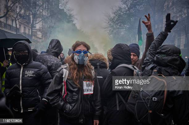 Protestors chant against President Macron as protestors and French Riot Police clash during a rally near Place de Republique in support of the...