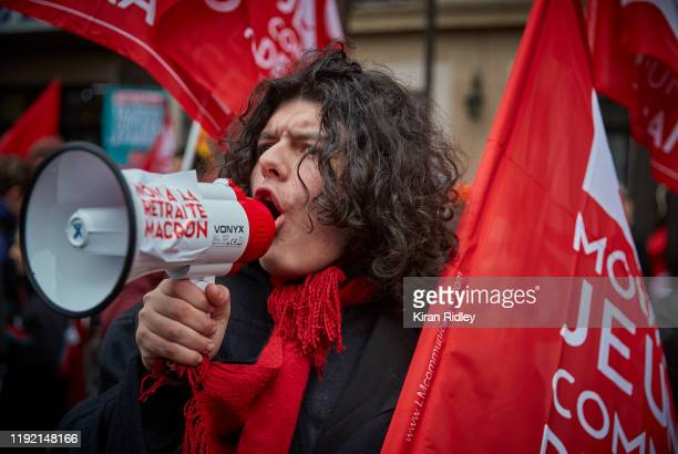 Protestors chant and sing songs against President Macron during a rally near Place de Republique in support of the national strike in France one of...