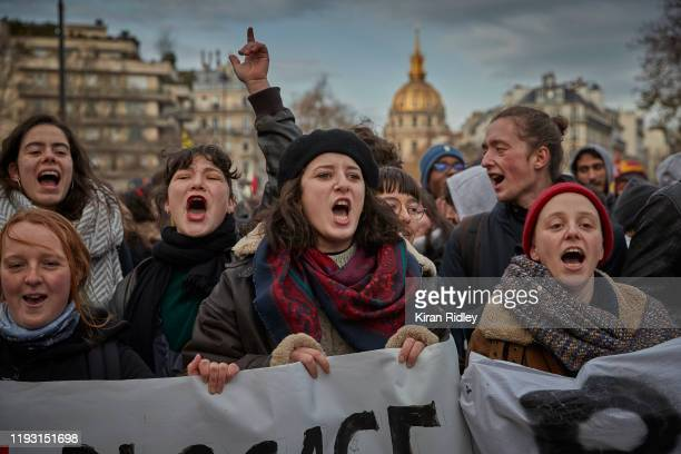 Protestors chant and sing songs against President Macron during a rally near Place des Invalides in Paris as thousands take to the streets to protest...