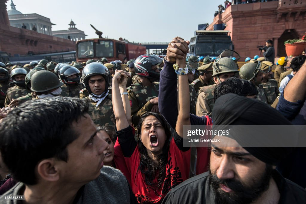 Protestors chant anti-police slogans as they form a line in front of cordon of Police dressed in riot gear during a protest against the Indian governments reaction to recent rape incidents in India in front of Rashtrapati Bhavan or the Presidential Palace on December 22, 2012 in New Delhi, India. Thousands of students gathered in front of the Presidential Palace in New Delhi to protest against current rape laws and the governments dealings of recent rape cases all over India.