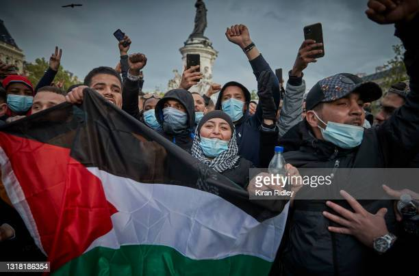 Protestors chant at Place de la Republique during a protest in solidarity with Palestine, after the recent Israeli attacks on Gaza on May 15, 2021 in...