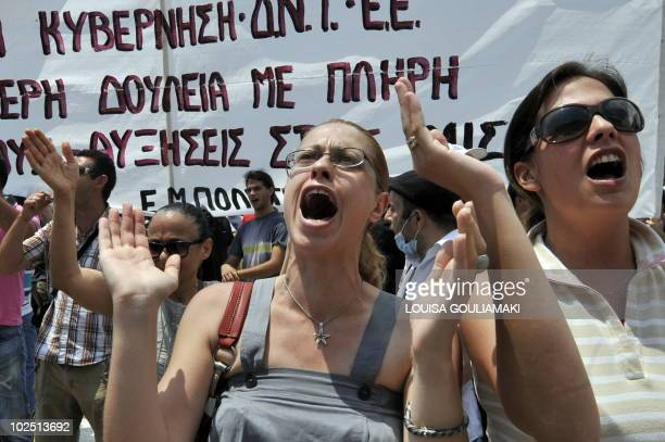 Protestors chant slogans in front of the parliament in the center of Athens on June 29 2010 during a protest march as part of a general strike...