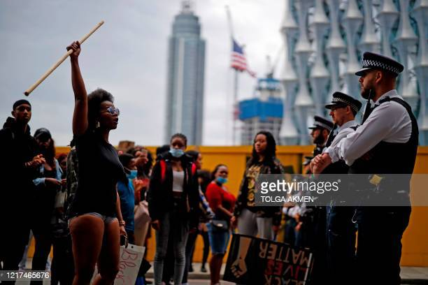 Protestors chant slogans s they confront police officers outside the US Embassy during an anti-racism demonstration in London on June 3 after George...