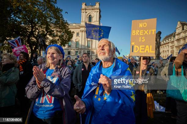 Protestors cheer during the People's Vote Rally in Parliament Square on October 19 2019 in London England Thousands have taken to the streets of...
