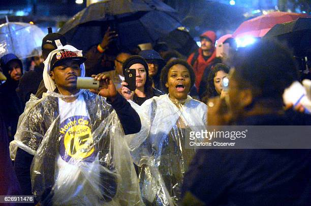 Protestors cheer on a speaker outside CharlotteMecklenburg Police Department HQ on Wednesday November 30 2016 in the aftermath of no indictment being...