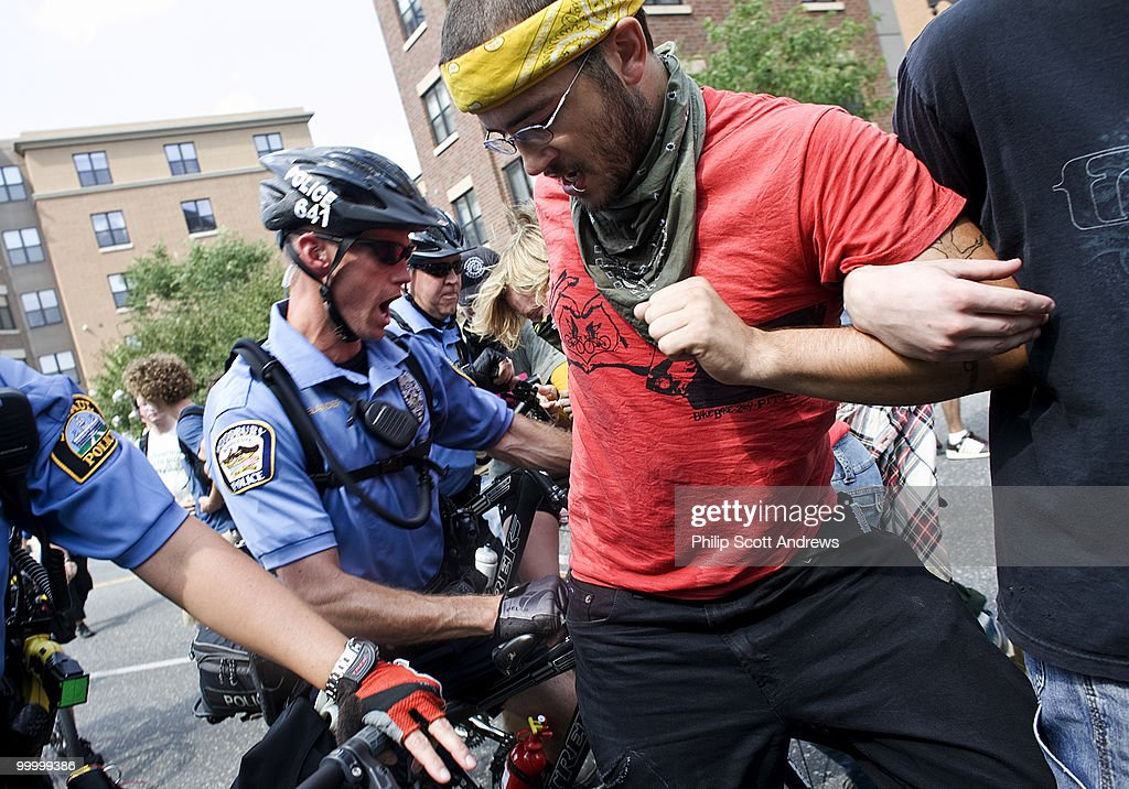 Protestors clash with bike police as they attempt to break through a blocked street in downtown St. Paul. the activists were met with tear gas, mace, and swiftly thrown handlebars as the demonstrated against the war in Iraq.
