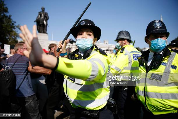 Protestors clash with Met Police officers during an Anti-Vax rally at Trafalgar Sq on September 19, 2020 in London, England.