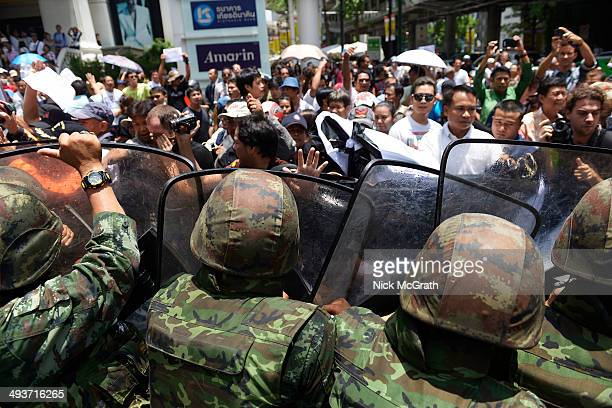 Protestors clash with military during anti coup protests on May 25, 2014 in Bangkok, Thailand. A small group of anti-coup protestors demonstrated in...