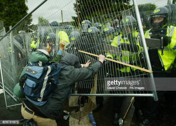 Protestors clash with police at the security fence near Aucterarder surrounding the G8 summit at Gleneagles