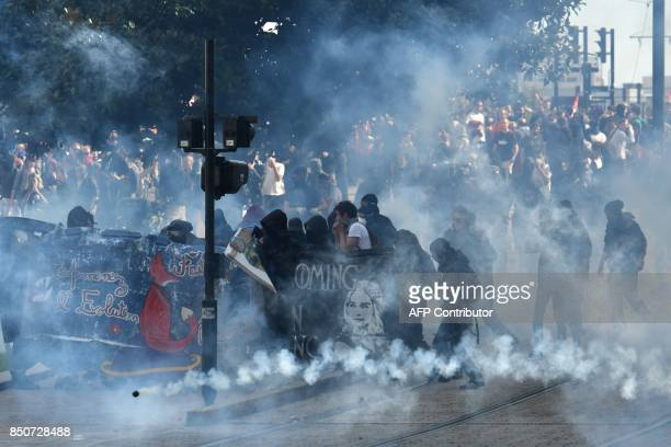 TOPSHOT Protestors clash with police during a demonstration against French government proposed labour law reforms on September 21 2017 in Nantes /...