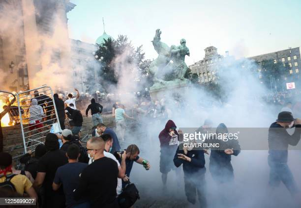 Protestors clash with police in Belgrade on July 8, 2020 as violence erupts against a weekend curfew announced to combat a resurgence of COVID-19...