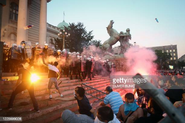 TOPSHOT Protestors clash with police in Belgrade on July 8 2020 as violence erupts against a weekend curfew announced to combat a resurgence of...