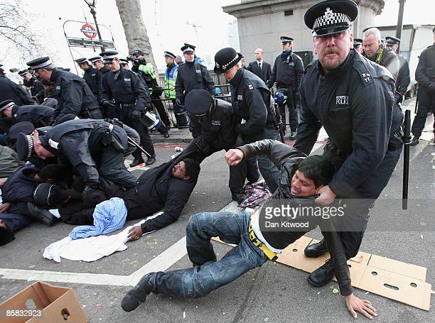 Protestors clash with police outside the Houses of Parliament as they demonstrate against alleged human rights abuses in Sri Lanka on April 7 2009 in...