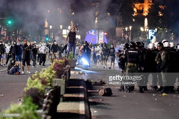 Protestors clash with Serbian police who fired tear gas in front of the National Assembly building in Belgrade, on July 7 to disperse thousands of...