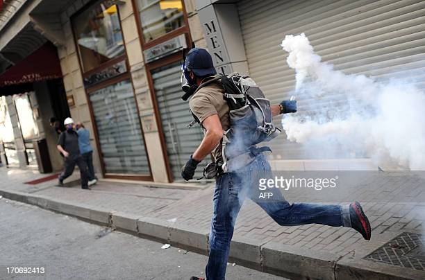 Protestors clash with Turkish policemen on the way to Taksim square in Istanbul on June 16 2013 Police fired tear gas and jets of water to disperse...