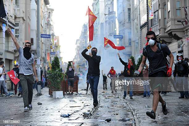 Protestors clash with Turkish riot policemen during a protest against the demolition of Taksim Gezi Park on May 31 in Taksim quarter of Istanbul....