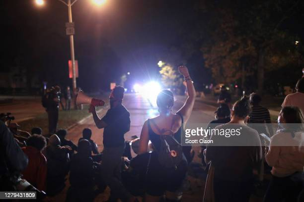 Protestors confront police as they demonstrate near the Wauwatosa City Hal on October 09, 2020 in Wauwatosa, Wisconsin. The city has faced three days...