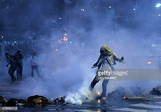 Protestors confront riot policemen during an antigovernment demo in Caracas on February 19 2014 Venezuelan President Nicolas Maduro successor of the...