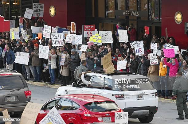 Protestors crowd the sidewalks at HartsfieldJackson Atlanta International Airport to denounce US President Donald Trump's executive order which...