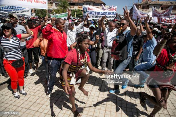 Protestors dance during a demonstration organised by opposition deputies calling for the resignation of the president on April 28, 2018 in...