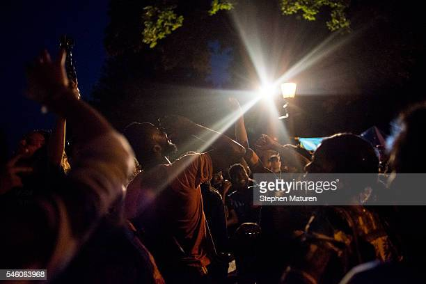 Protestors dance outside the Governor's Mansion on July 10 2016 in St Paul Minnesota The area outside the Governor's Mansion has been occupied by...
