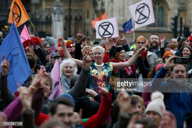 Protestors dancing as they participate in Extinction Rebellion's Enough Is Enough march in Parliament Square on February 22 2020 in London England