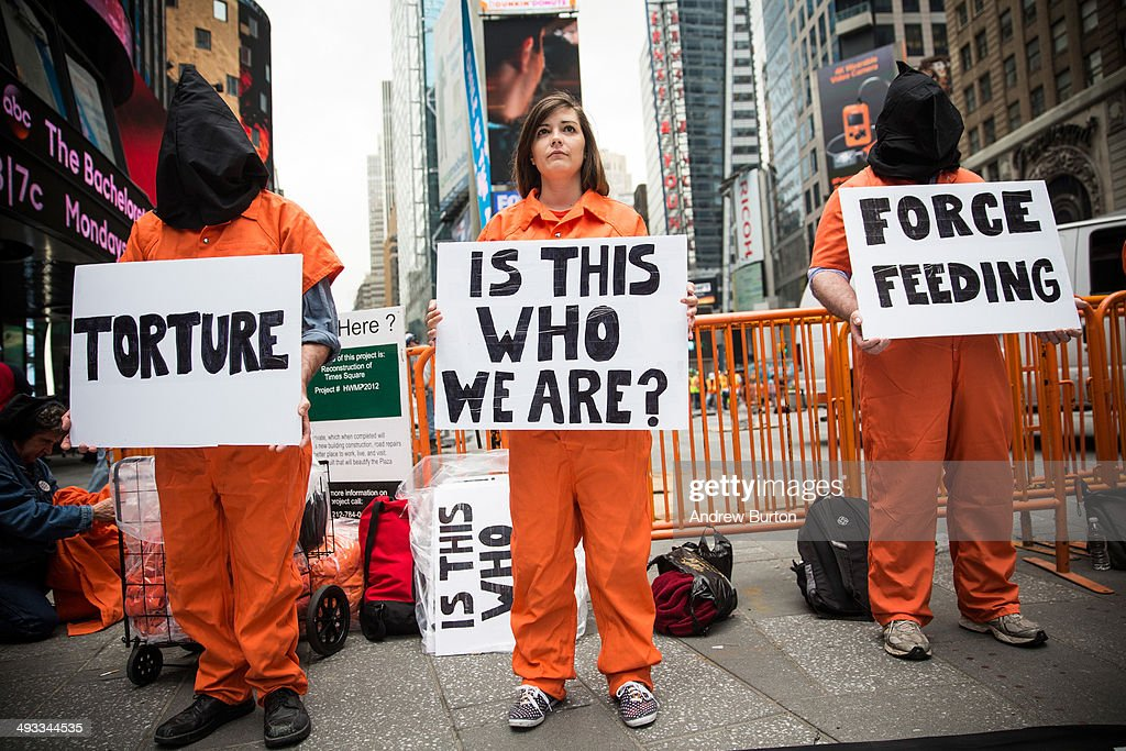 Protestors demand the closure of the Guantanamo Bay detention center, used by U.S. military forces to hold people indefinitely, in Times Square on May 23, 2014 in New York City. Organizers of the protest claimed the gathering was in coordination with protests happening in 40 other cities.