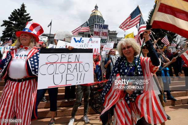 Protestors demonstrate against new safer-at-home orders during the End the Lockdown Now rally at the Colorado Capital in Denver, Colorado on April...