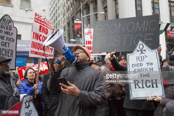 Protestors demonstrate against the 2017 tax bill about to be passed by a Republican congress on December 19 2017 on Wall Street in New York City...